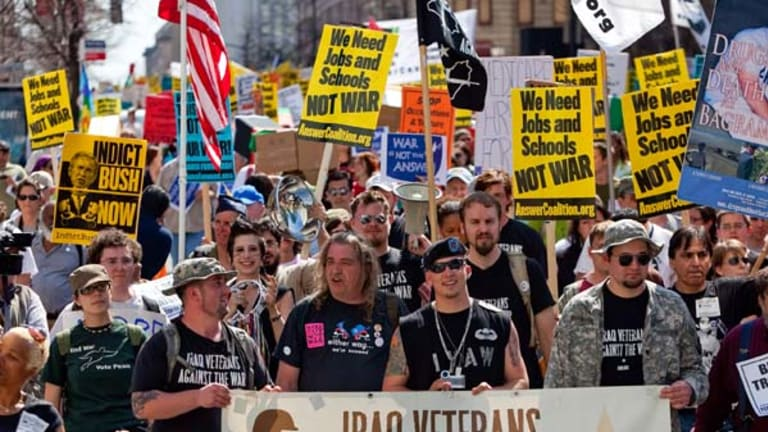 Protesters calling for an immediate end to the wars in Iraq and Afghanistan march through the streets in Washington, DC.