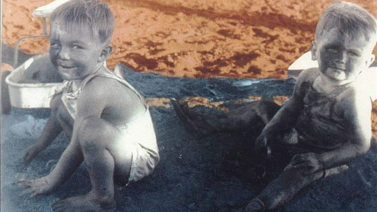 Phillip Noble and Ross Munroe play in a sand pit of asbestos. Photo courtesy of the Asbestos Diseases Society of Australia.