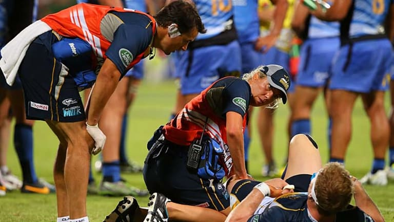 Knee injury: David Pocock of the Brumbies receives medical attention during round three of the Super Rugby match against the Western Force.