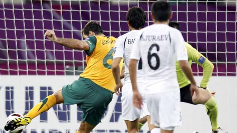 Sasa Ognenovski shoots to score against Uzbekistan.