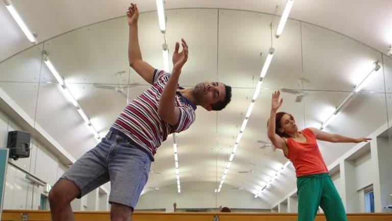"Raghav Handa, left, and Vicki Van Hout during rehearsals for the performance ""Slow Dances for Fast Times."""