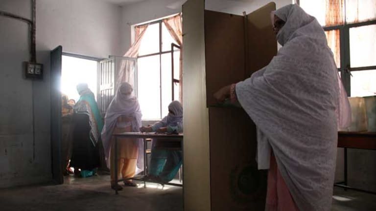 Saira casts her vote in Pakistan's general election on Saturday. More women were registered to vote than in any previous poll in the country. But women were still disenfranchised. In conservative areas, clerics banned women from voting or threatened punishment for their families if they did. In Peshawar militants tried to kill women voters.