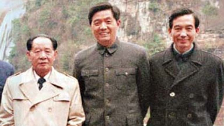 "Working for ""the happiness of the people"" ...  Hu Yaobang, left, with the  future leaders Hu Jintao, centre, and Wen Jiabao in 1986."