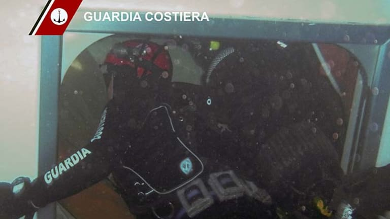 First pictures ... A diver swims inside the wrecked cruise ship on a rescue mission.