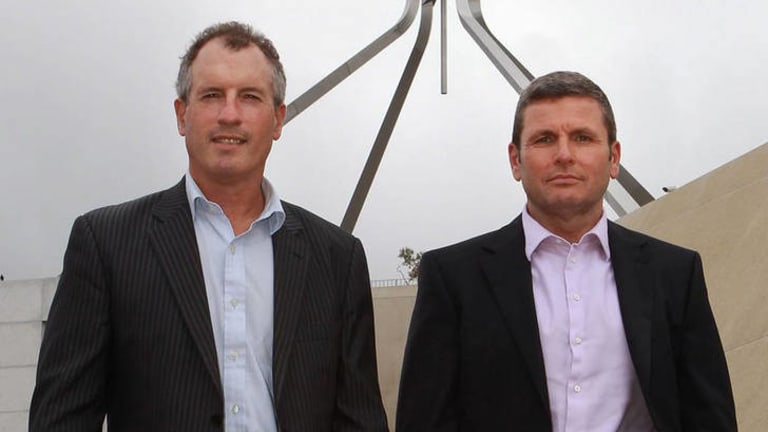 Journalists Steve Lewis and Chris Uhlmann in front of Parliament House.