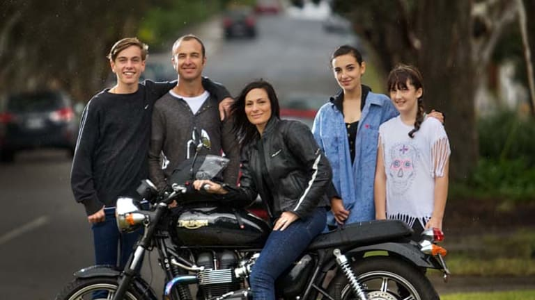 Darrylin Galanos with her motorbike and her family (from left) Isaac, Graeme, Grace and Jemma Gbbons.