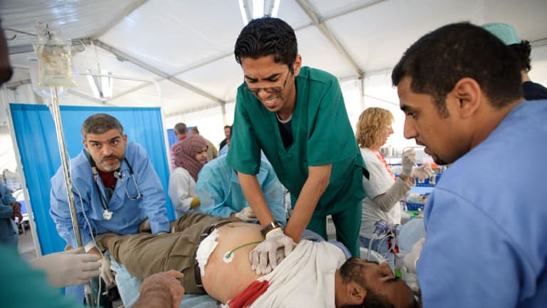 Medics try to save a combatant.