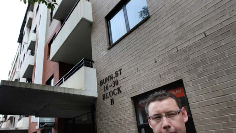 Disheartened … Mark Terry in front of his flat.