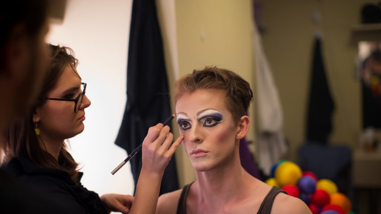 The finishing touches are applied to Adam Noviello's eye make-up.