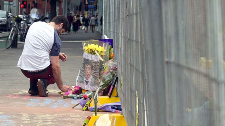 Tributes have been left at a makeshift memorial.