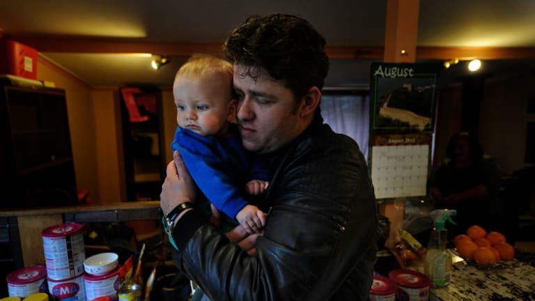 Jason Richards with his son Jonas Richards, 7 months. Jason's wife Kelly died in hospital after a routine operation. Read the family's story on the front page today.