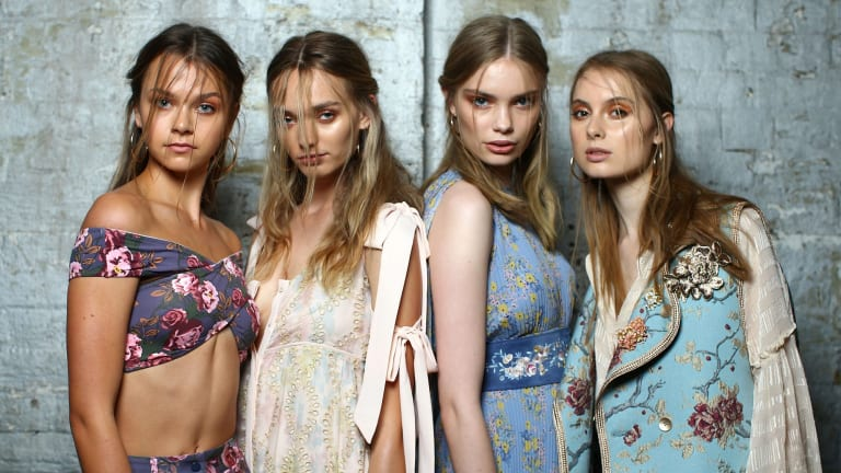 Models pose backstage ahead of the We Are Kindred show.
