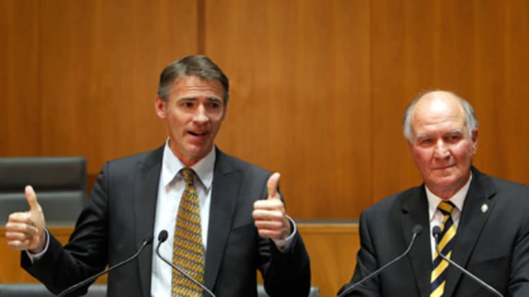 Thumbs up for Labor ... Rob Oakeshott and Tony Windsor give their support to Julia Gillard.