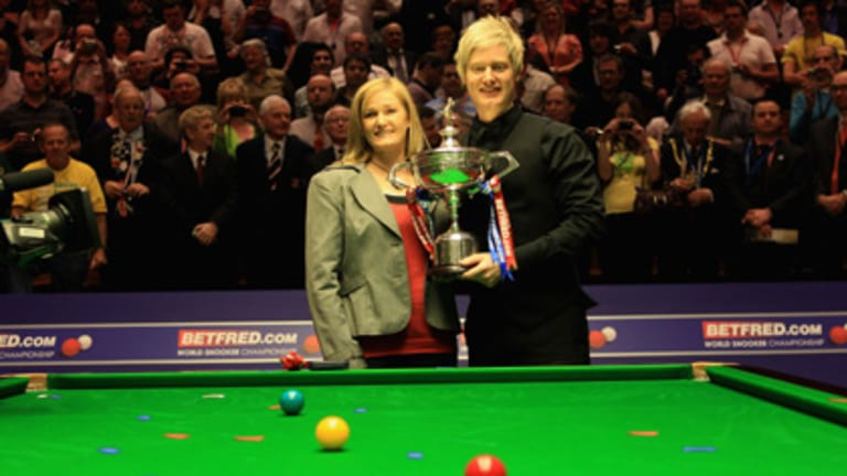 Melbourne snooker star Neil Robertson poses with his mother, Alison Hunter, after winning the world title in Sheffield, England.