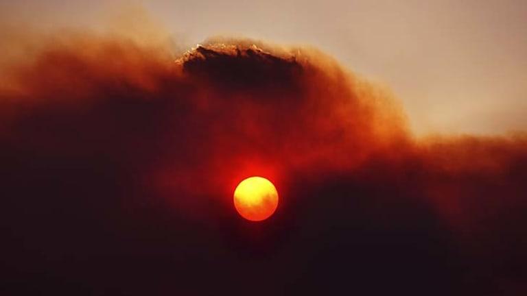 The sun glows through smoke haze at Lake Repulse, 80km north-west of Hobart.