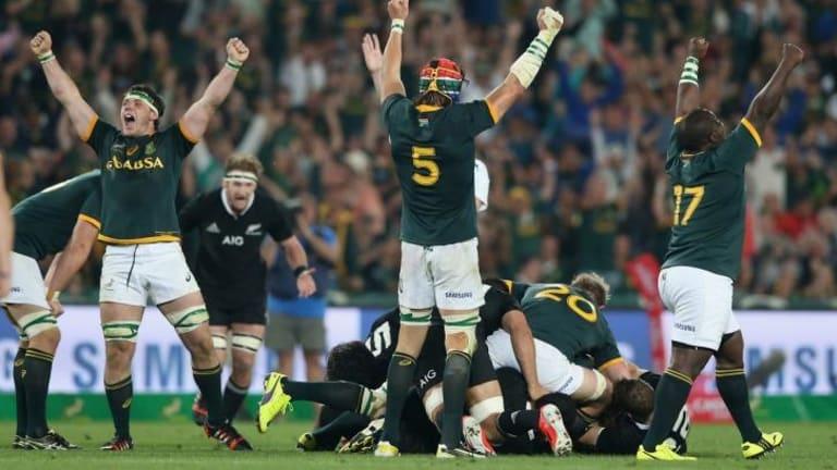 Jubilation: Springboks  rejoice as the full-time whistle sounded at Ellis Park.