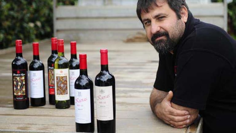 Emanuel Skorpos with a selection of Flinders Run wines alongside a counterfeit Chinese copy, on the right.