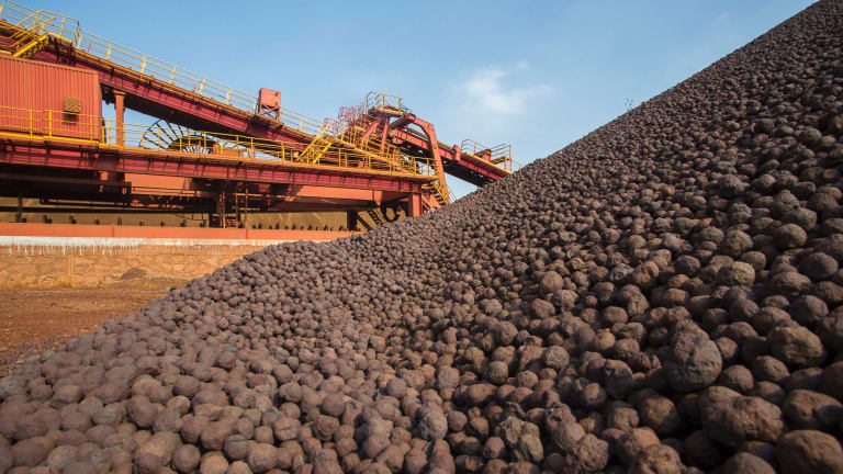 The sharemarket on Friday managed to shrug off a slide in commodities.