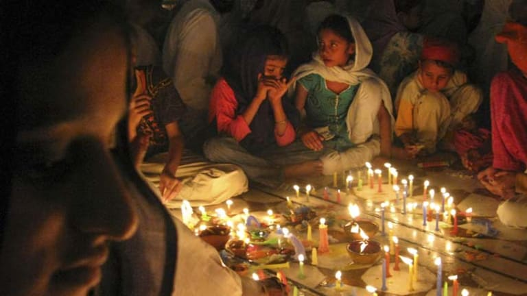 Festival of lights ... Hindus in India celebrate Diwali with candles, feasting and fireworks to scare off evil spirits.