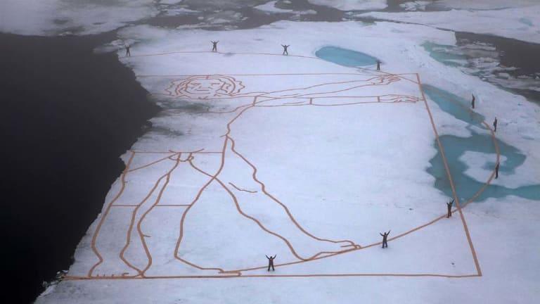 Art for action ... the artist John Quigley recreated Leonardo da Vinci's Vitruvian Man on ice to highlight the melting Arctic.