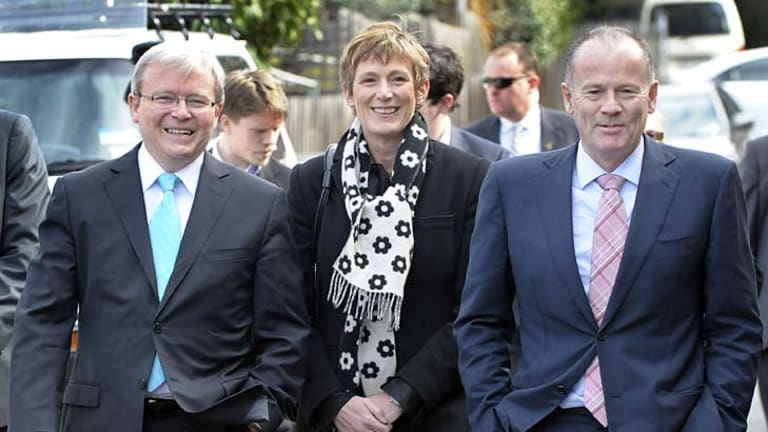 Axed ... Former Prime Minister Kevin Rudd, left, walks with Lindsay Tanner, far right, in August 2010.