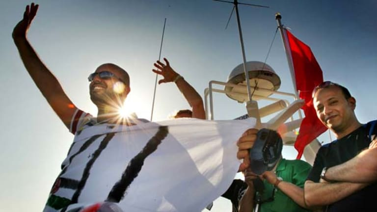 Activists on the Amal passenger boat wave farewell as they set sail from Aghios Nikolaos in Crete, Greece, to join the Free Gaza flotilla.