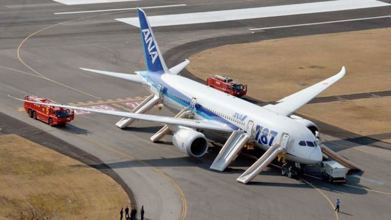 An All Nippon Airways (ANA) Boeing 787 Dreamliner is seen after making an emergency landing at Takamatsu airport in  western Japan January 16, 2013. The plane landed after after smoke appeared in the plane's cockpit, but all 137 passengers and crew members were evacuated safely.