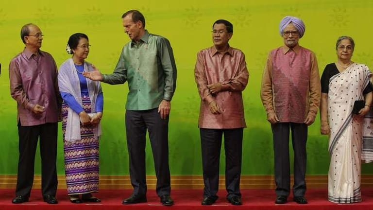 President of Myanmar Thein Sein and his wife Khin Khin Win, Prime Minister Tony Abbott, Cambodian Prime Minister Hun Sen, Indian Prime Minister Manmohan Singh and his wife Gursharan Kaur, during a group photo at the East Asia Summit in Brunei.