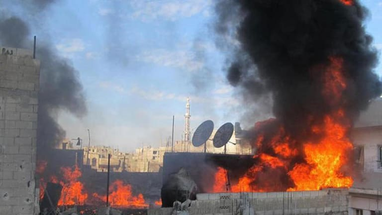 A fire on the roof of a building in the Baba Amor neighborhoud of the flashpoint city of Homs.