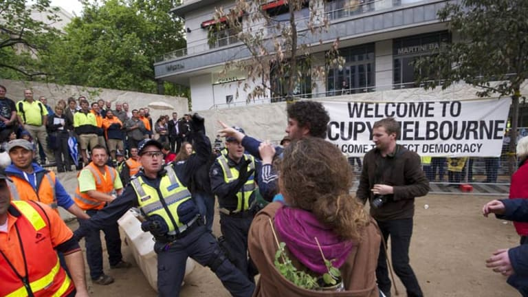 An officer confronts protesters in City Square.