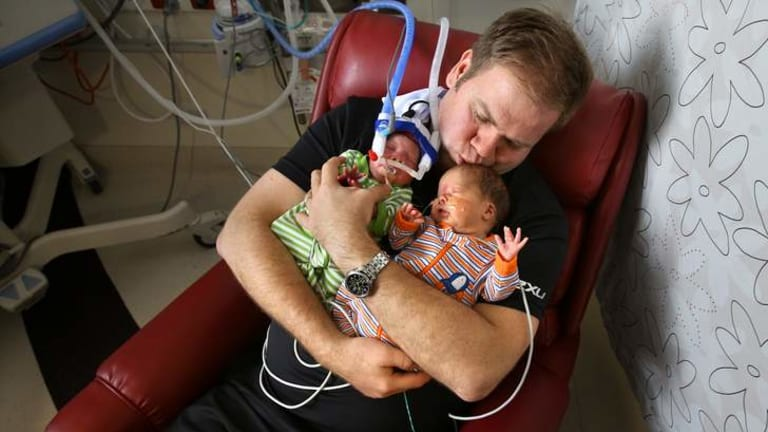 Radford White with premature twins Rupert and Maisie.