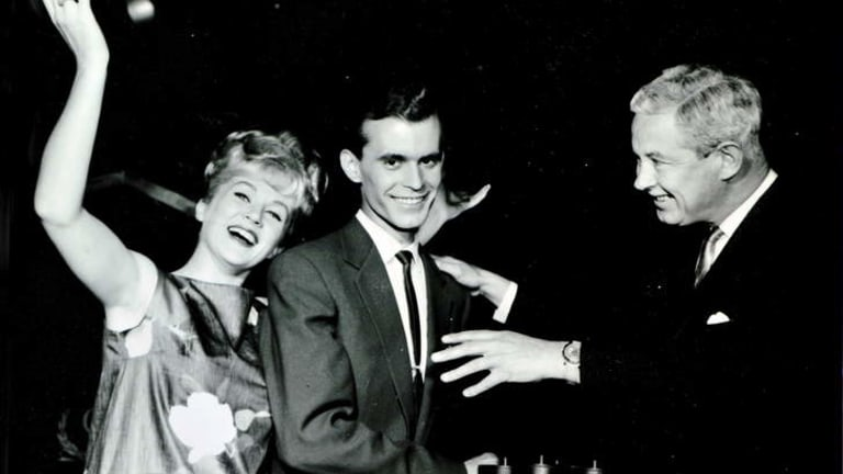 Melbourne September 1963- Mario Despoja with Beverley Robbins, hostess and Roland Strong, producer-compere of Coles 3000 Pound question.