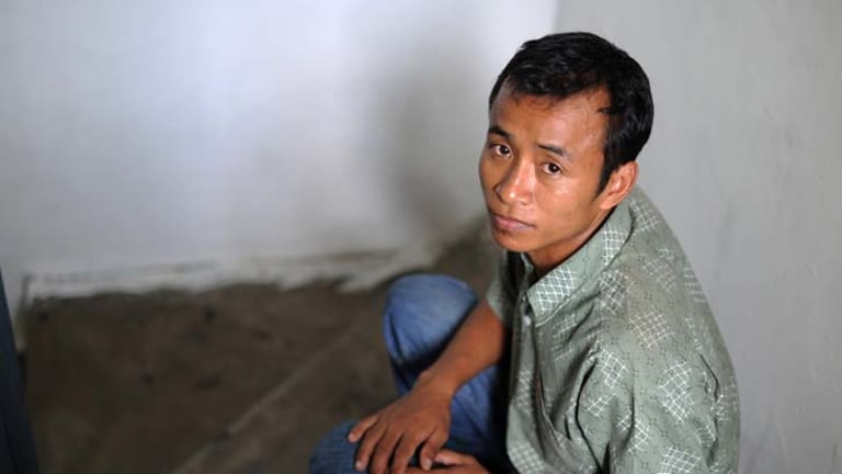 In detention for seven months ... Thawng Lian Thang's ordeal began after a gang stole his refugee card.