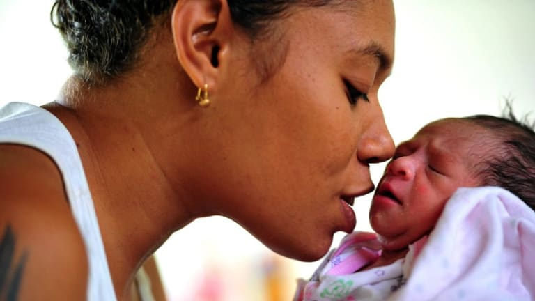A new mother and her baby at the maternity ward at Port Moresby General hospital.