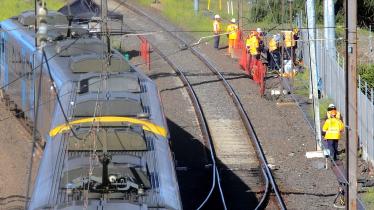 Workers inspect the damage near Richmond station on Wednesday.