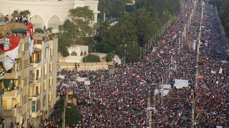 Protesters opposing Egyptian President Mohamed Morsi fill the streets in front of El-Thadiya presidential palace in Cairo on June 30.