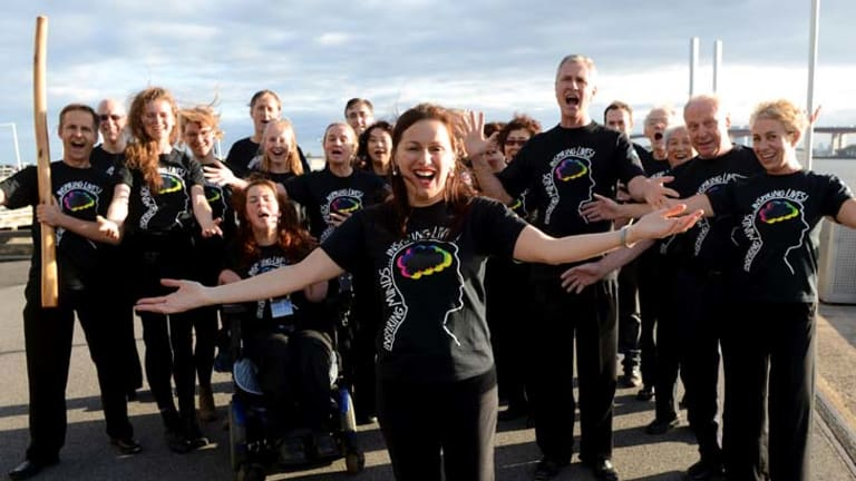 ''When our choirs perform, the audiences usually give a standing ovation'' … Tania de Jong stands in front of one of her singing groups. She is starting a choir in Sydney for people from all walks of life.