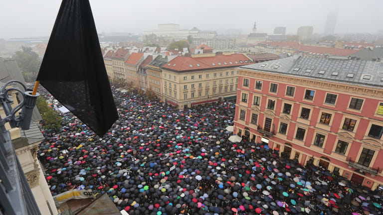 Thousands of women participate in the nationwide Black Monday strike to protest a legislative proposal for a total ban on abortion in Warsaw, Poland, in October last year.