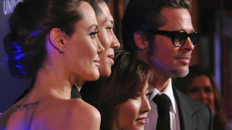 Angelina Jolie, cast member Miyavi, his wife Melody Ishihara and Brad Pitt at the Sydney premiere of <i>Unbroken</i>.
