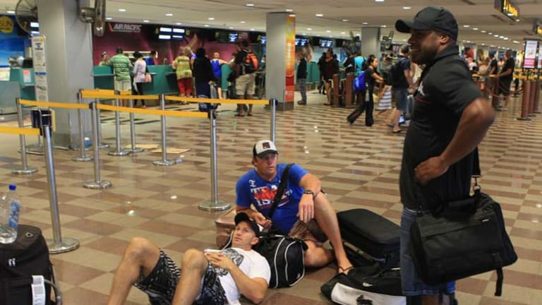 Grounded ... former NRL players Adam MacDougall and Rhys Wesser flank current Manly Sea Eagles player Matt Cross.