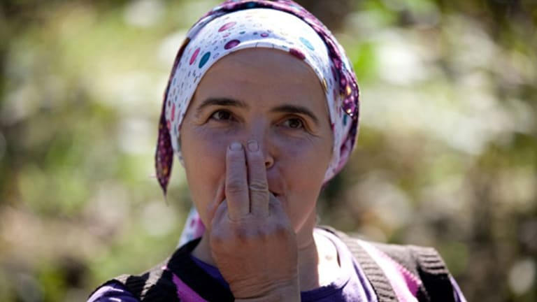 A woman whistling in a still from <i>The Calling</i> by  Angelica Mesiti.