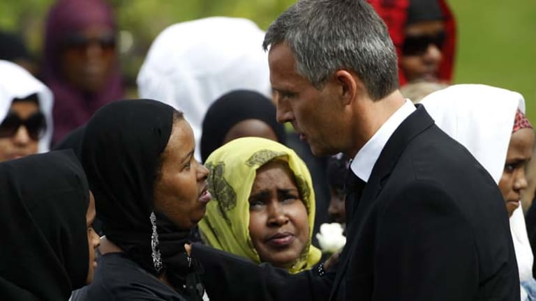 Grieving ... Norway's Prime Minister, Jens Stoltenberg, comforts a relative at the funeral of a woman killed by Breivik.