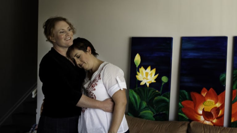 Bridget, left, and Tammy Clinch at home in Queensland one year after Bridget began gender reassignment therapy.