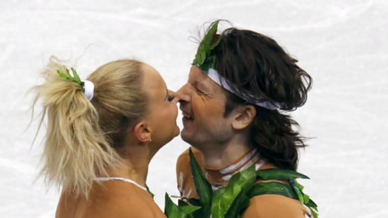 Russia's Oksana Domnina and Maxim Shabalin rub noses at the end of their performance in the ice dance original dance figure skating event.