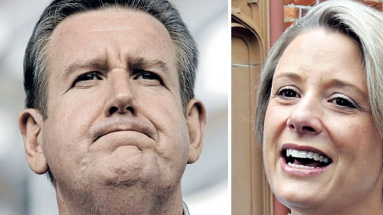 The morning after: the enormity of his landslide win over Kristina Keneally (right) appears to finally dawn on NSW premier-elect Barry O'Farrell.