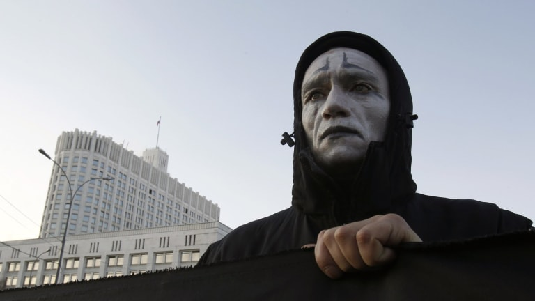 An activist holds a banner during a rally on World AIDS day to protest against government policies, in front of the Russian White House in Moscow in 2010.