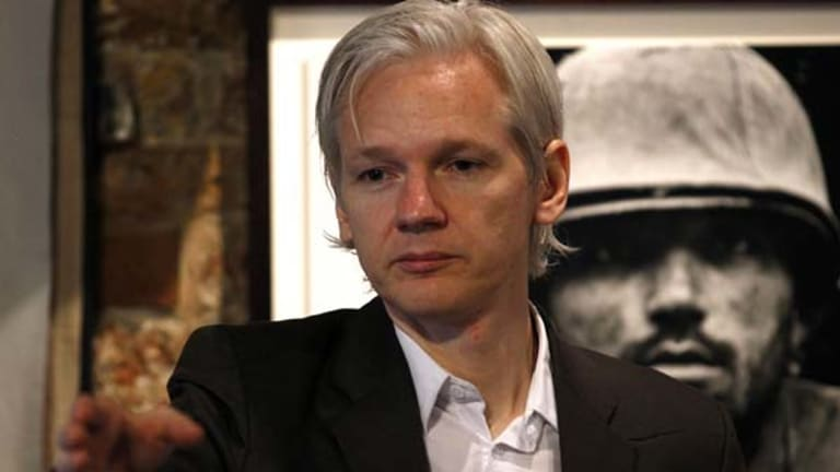 """""""Suspicious"""" . . . Julian Assange addresses journalists in London about the leaking of Afghan war documents."""