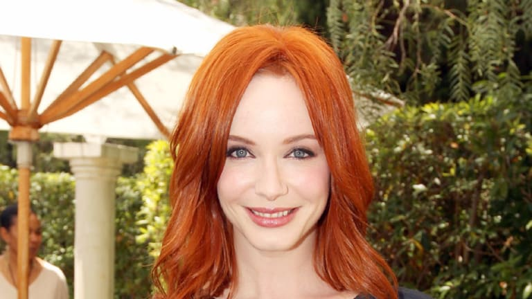 Driving men mad ... Christina Hendricks makes the most of her curves.
