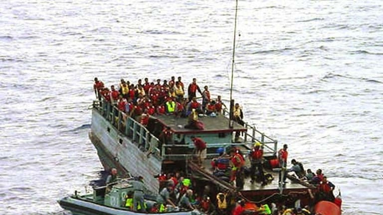 Australian navy personnel rescue asylum-seekers from a sinking boat off Christmas Island in 2001. The Howard Government later falsely claimed the refugees had thrown children overboard. <i>The Age</i> has tracked down an interviewed asylum seekers involved with the Tampa. Their stories are on this page.