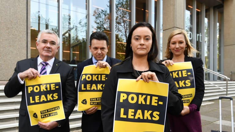 Federal MPs, from left, Andrew Wilkie, Nick Xenophon and Larissa Waters, far right, with former problem gambler Shonica Guy, calling for the release of poker machine industry secrets.
